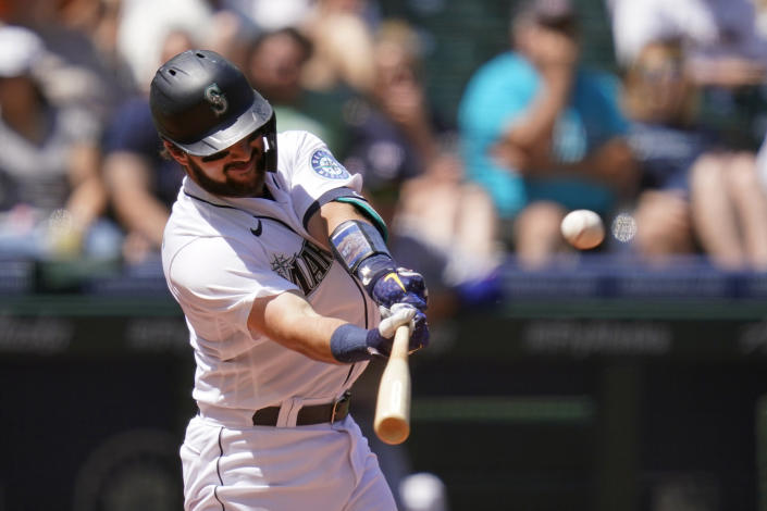 Seattle Mariners' Luis Torrens connects for a three-run home run against the Texas Rangers in the fourth inning of a baseball game Sunday, July 4, 2021, in Seattle. (AP Photo/Elaine Thompson)