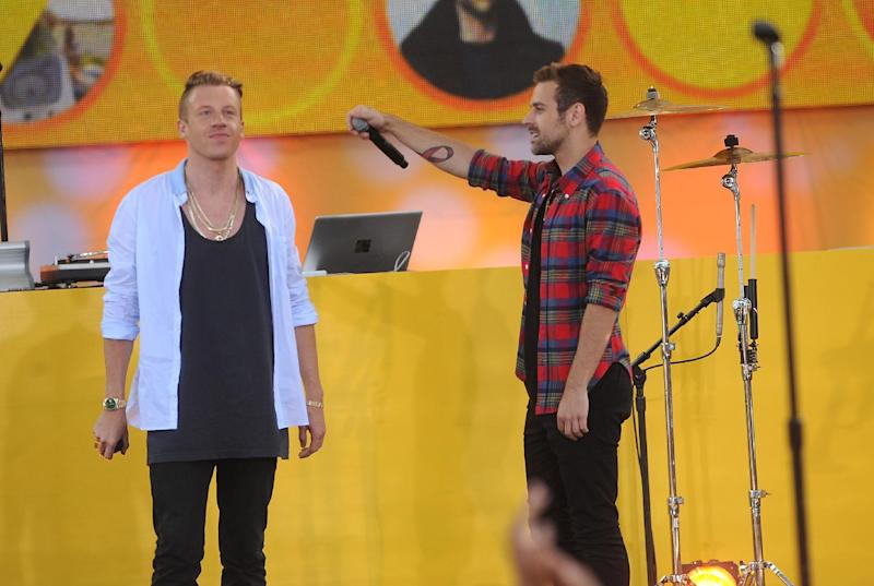 FILE - In this Aug. 16, 2013 file photo, musician Ben Haggerty, left, also known as Macklemore, and Ryan Lewis perform on stage at the Good Morning America Concert Series at Central Park's Rumsey Playfield in New York City. Macklemore and Lewis were among the top nominees for the 56th annual Grammy Awards announced Friday night, Dec. 6, 2013. (Photo by Brad Barket/Invision/AP, File)
