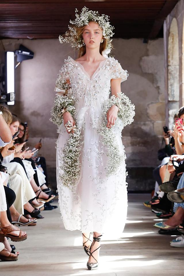 <p><i>White wedding gown with floral appliqués from the SS18 Rodarte collection. (Photo: ImaxTree) </i></p>