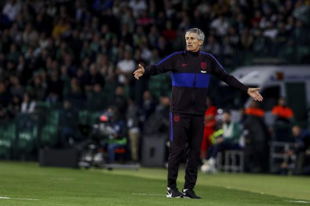 Barcelona's head coach Quique Setien gestures during La Liga soccer match between Betis and Barcelona at the Benito Villamarin stadium in Seville, Spain, Sunday, Feb. 9, 2020. (AP Photo/Miguel Morenatti)