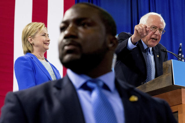 FILE - In this July 12, 2016, file photo, a member of the Secret Service stands guard as Sen. Bernie Sanders, I-Vt., accompanied by Democratic presidential candidate Hillary Clinton, speaks during a rally in Portsmouth, N.H., where Sanders endorsed Clinton for president. (AP Photo/Andrew Harnik, File)