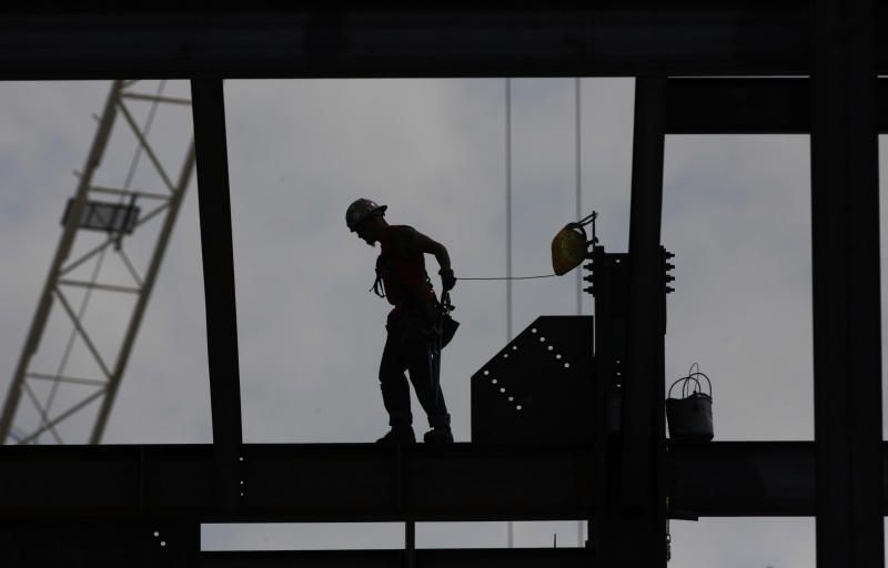 An ironworker walks across a beam on a building under construction at Drexel University, Monday, July 9, 2012, in Philadelphia. U.S. construction spending likely increased in June, helped by further gains in home construction. In May, construction spending increased 0.9 percent to a seasonally adjusted annual rate of $830 billion. The annual rate of spending is 11.3 percent above a 12-year low hit in February 2011. Still, the level of spending is about half of what economists consider to be healthy. The construction industry is showing signs of improvement while other parts of the economy have slumped. (AP Photo/Brynn Anderson)