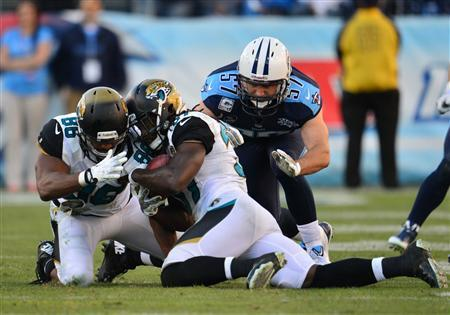 Nov 10, 2013; Nashville, TN, USA; Jacksonville Jaguars safety Johnathan Cyprien (37) recovers an onside kick against the Tennessee Titans during the second half at LP Field. The Jaguars beat the Titans 29-27. Mandatory Credit: Don McPeak-USA TODAY Sports