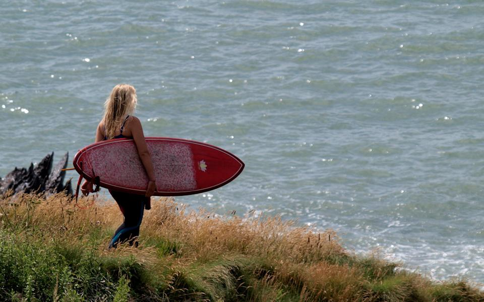Surfer heading to Woolacombe - Getty