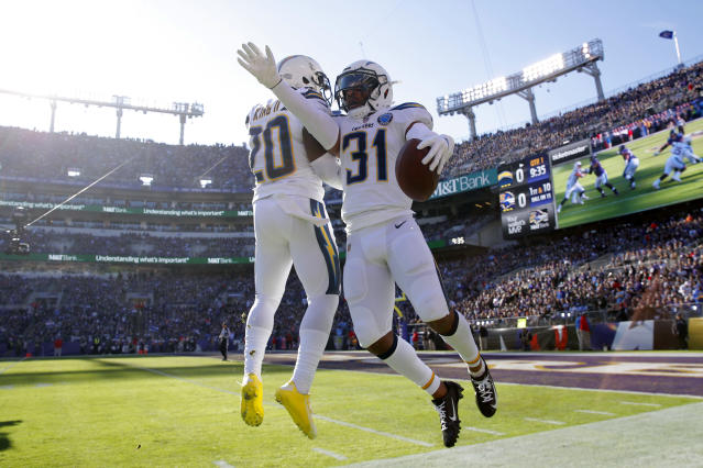 Los Angeles Chargers defensive back Adrian Phillips, right, celebrates with teammate Desmond King after recovering a fumble against Baltimore. (AP)
