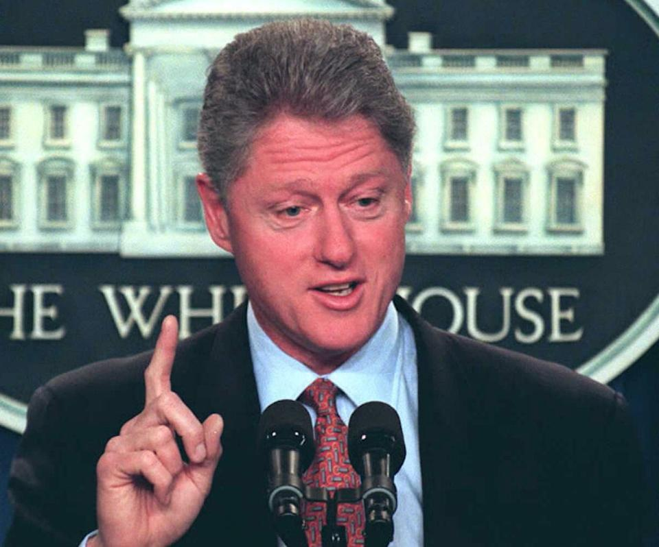 U.S. President Bill Clinton emphasizes a point during a press conference at the White House in Washington, DC, on May 08, 1996. (Photo: RICHARD ELLIS/AFP/Getty Images)