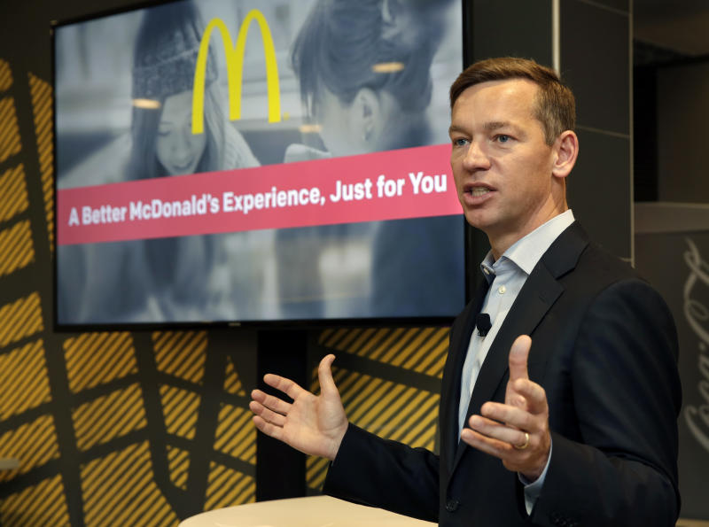 In this Thursday, Nov. 17, 2016, photo, Chris Kempczinski, incoming president of McDonald's USA, speaks during a presentation at a McDonald's restaurant in New York's Tribeca neighborhood. Artisan burger buns, cage-free eggs and table service are some of the changes McDonald's is promising in the U.S. as it scrambles to update its image and win back customers. (AP Photo/Richard Drew)