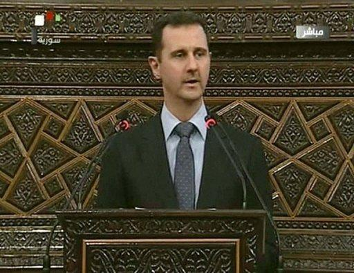 An image grab taken from Syrian state TV shows Syrian President Bashar al-Assad addressing the parliament in Damascus. Assad on Sunday dismissed allegations that his government had a hand in the Houla massacre and accused foreign-backed forces of plotting to destroy Syria