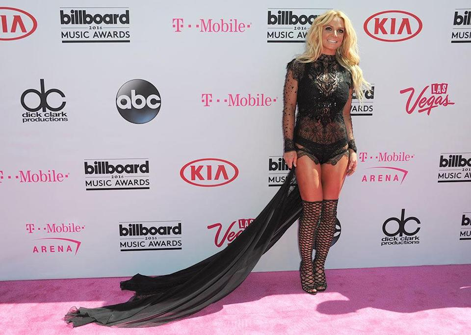 <p>Spears will not only be accepting the Millennium Award, the sultry songstress is also opening the star-studded show — in her adopted home of Sin City — with a medley of her biggest hits. This leggy look is classic Brit, with her rocking body on display in a lingerie-inspired bodysuit and thigh-high cage boots. <i>(Photo: Richard Shotwell/Invision/AP)</i></p>