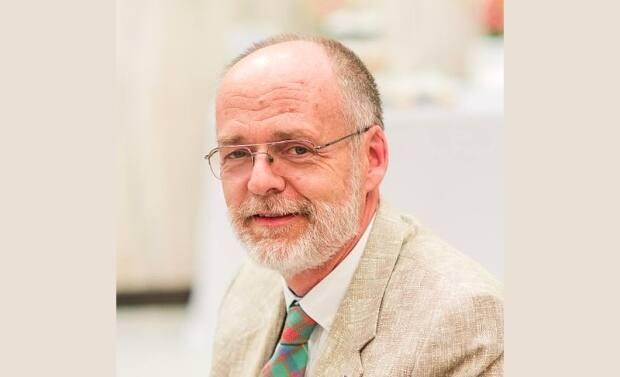 Ian MacIntosh, retired head librarian at the Cape Breton-Victoria Regional Library, died recently and is being remembered as a friendly but passionate advocate for the library system. (Submitted by Kathy MacIntosh - image credit)