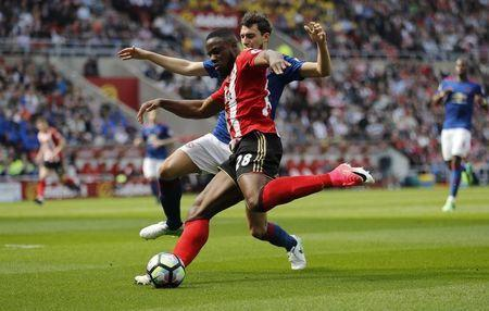 Britain Football Soccer - Sunderland v Manchester United - Premier League - Stadium of Light - 9/4/17 Sunderland's Victor Anichebe in action with Manchester United's Matteo Darmian Reuters / Russell Cheyne Livepic