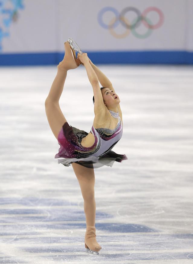 Kanako Murakami of Japan competes in the women's short program figure skating competition at the Iceberg Skating Palace during the 2014 Winter Olympics, Wednesday, Feb. 19, 2014, in Sochi, Russia. (AP Photo/Vadim Ghirda)