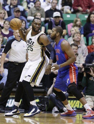 Detroit Pistons' Greg Monroe, right, guards Utah Jazz's Al Jefferson (25) in the first quarter during an NBA basketball game Monday, March 11, 2013, in Salt Lake City. (AP Photo/Rick Bowmer)
