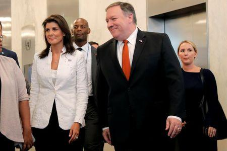 U.S. Secretary of State Mike Pompeo and United Nations Ambassador Nikki Haley walk to press briefing at U.N. headquarters in New York