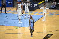 Memphis Grizzlies guard Ja Morant (12) reacts to a missed opportunity during the final minutes of Game 3 of an NBA basketball first-round playoff series against the Utah Jazz, Saturday, May 29, 2021, in Memphis, Tenn. Utah won 121-111.(AP Photo/John Amis)