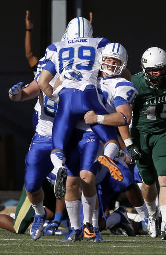 Middle Tennessee State Josh Davis (48) picks up kicker Cody Clark (89) in celebration after kicking the winning field goal to beat UAB 24-21 during the second half of an NCAA college football game on Saturday, Nov. 1, 2013, in Birmingham, Ala. (AP Photo/Butch Dill)