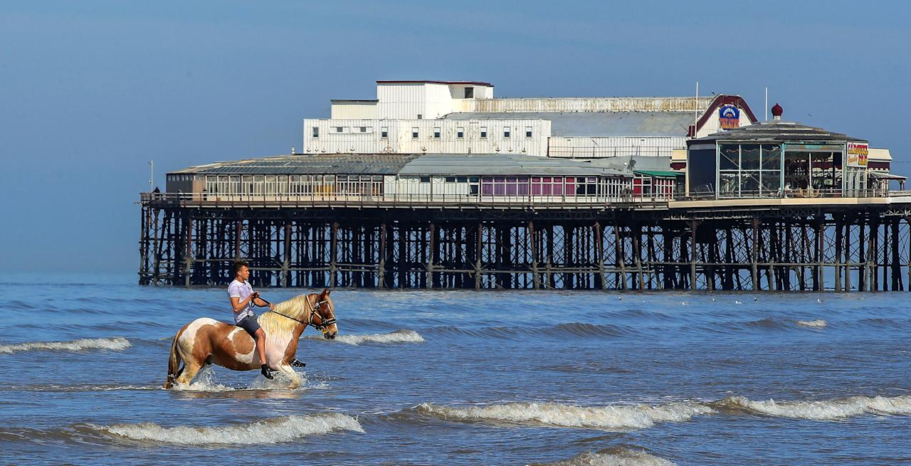 <p>Hercules the Blackpool horse cools down in the sea with rider Tyrone, on what is believed to be the hottest day of the year so far. (Peter Byrne/PA Wire) </p>