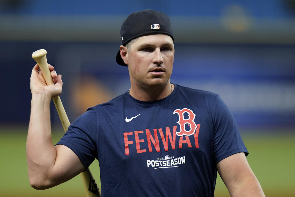 Boston Red Sox right fielder Hunter Renfroe swings a bat during the baseball team's practice Wednesday, Oct. 6, 2021, in St. Petersburg, Fla., for an AL Division Series matchup against the Tampa Bay Rays that starts Thursday. (AP Photo/Chris O'Meara)