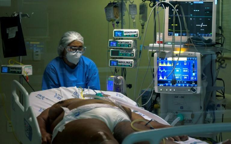 A health worker cares for a Covid-19 patient in the intensive care unit of Emilio Ribas Hospital in Sao Paulo, Brazil, on March 17, 2021