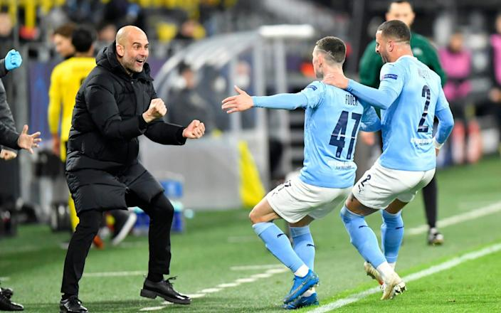 Pep Guardiola's Manchester City are still on course for an historic quadruple this season after beating Borussia Dortmund in the Champions League quarter-finals - Martin Meissner/AP POOL
