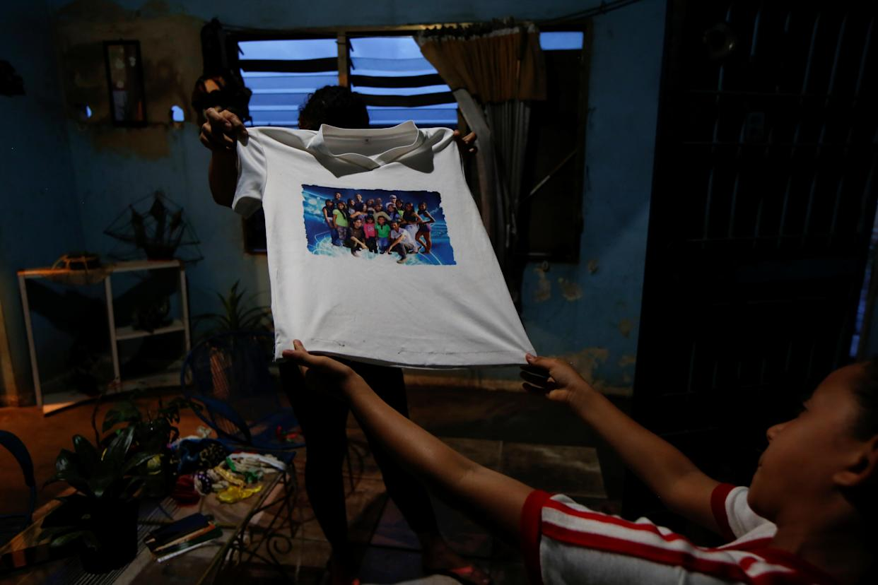 Relatives of Maroly Bastardo show a T-shirt of Maroly at their home in El Tigre, Venezuela, on June 4. (Photo: Ivan Alvarado/Reuters)