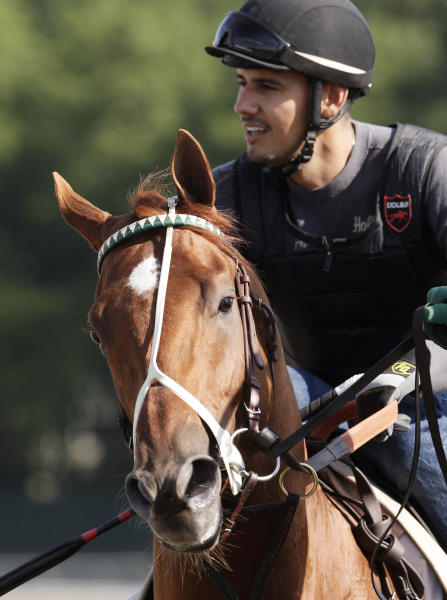 I'll Have Another, with exercise rider Jonny Garcia up, trains at Belmont Park, Wednesday, June 6, 2012, in Elmont, N.Y. The winner of the Kentucky Derby and Preakness will attempt to win the Belmont Stakes and Triple Crown on Saturday. (AP Photo/Mark Lennihan)