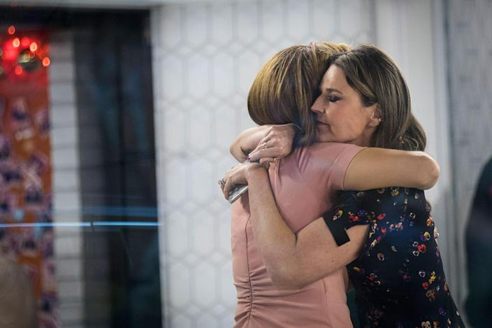 <p>NOV. 29, 2017 – Hoda Kotb, left and Savannah Guthrie embrace at the end of the show on the set of NBC's Today Show in New York City. It was announced on Wednesday morning that long time Today Show host Matt Lauer had been fired for alleged sexual misconduct. (Photo: Drew Angerer/Getty Images) </p>