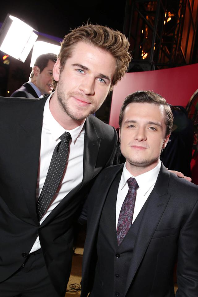 Liam Hemsworth and Josh Hutcherson seen at Lionsgate's 'The Hunger Games: Catching Fire' Los Angeles Premiere, on Monday, Nov, 18, 2013 in Los Angeles. (Photo by Eric Charbonneau/Invision for Lionsgate/AP Images)