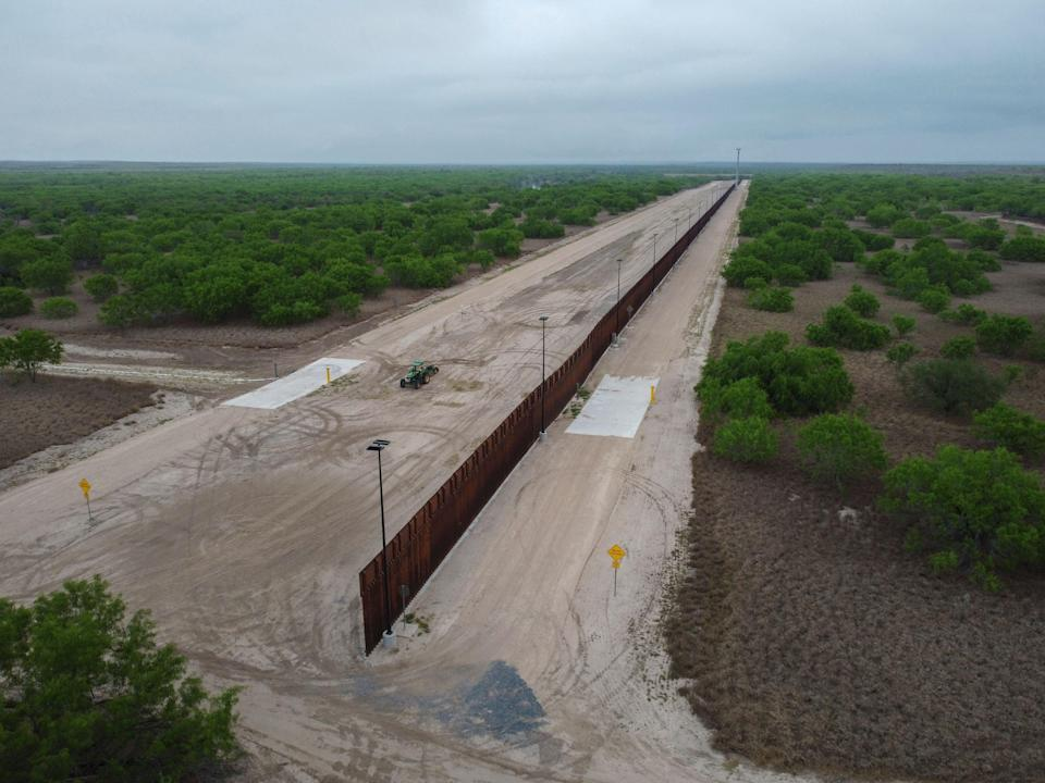 A photo taken on March 30, 2021 shows a general view of an unfinished section of a border wall that former US president Donald Trump tried to build near the southern Texas border city of Roma (AFP via Getty Images)