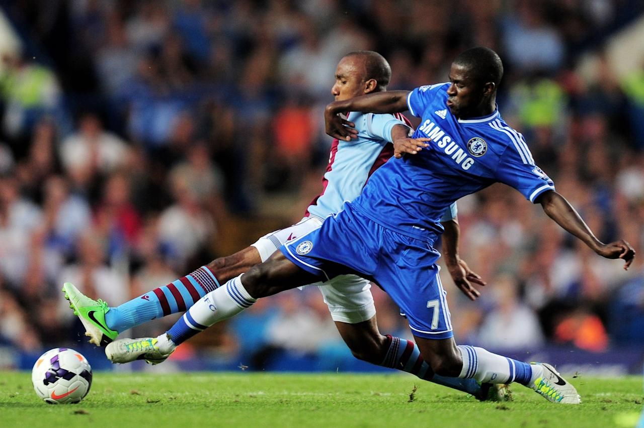 LONDON, ENGLAND - AUGUST 21: Karim El Ahmadi of Aston Villa and Ramires of Chelsea compete for the ball during the Barclays Premier League match between Chelsea and Aston Villa at Stamford Bridge on August 21, 2013 in London, England. (Photo by Jamie McDonald/Getty Images)