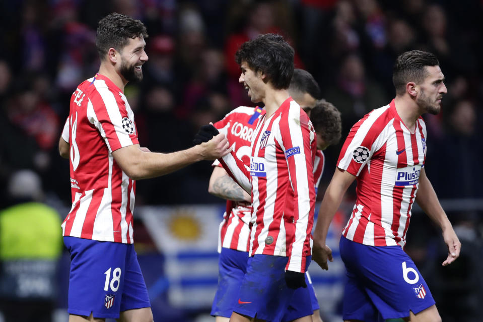 Atletico Madrid's Felipe, left, celebrates with Atletico Madrid's Joao Felix after scoring the the second goal during the Champions League Group D soccer match between Atletico Madrid and Lokomotiv Moscow at Wanda Metropolitano stadium in Madrid, Spain, Wednesday, Dec. 11, 2019. (AP Photo/Manu Fernandez)