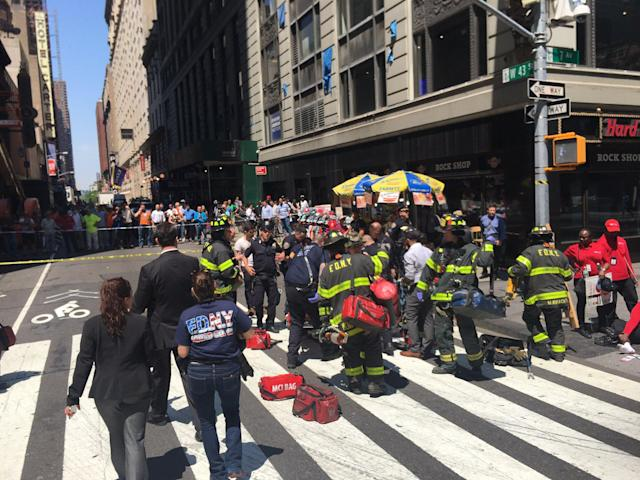 <p>First responders assist at the scene of motor vehicle accident in Times Square, New York City on May 18, 2017. (FDNY via Twitter) </p>