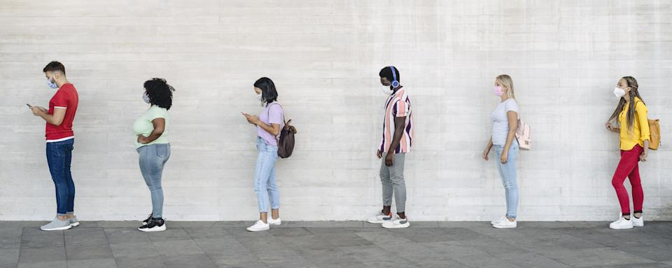 Young people from different cultures and race waiting