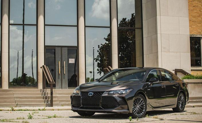 """<p>Riding on Toyota's latest platform—which also underpins the new Camry, RAV4, Prius, and others—<a href=""""https://www.caranddriver.com/toyota/avalon"""" rel=""""nofollow noopener"""" target=""""_blank"""" data-ylk=""""slk:the 2019 Avalon hybrid"""" class=""""link rapid-noclick-resp"""">the 2019 Avalon hybrid</a> boasts a stiff-feeling structure and confident handling that makes it far more enjoyable to drive than before (just like its gas-powered sibling). An EPA combined rating of 44 mpg adds to its appeal—keep in mind, that number is quite good for something so large—as does its well-trimmed cabin and chiseled, if slightly overwrought, styling.<br></p>"""