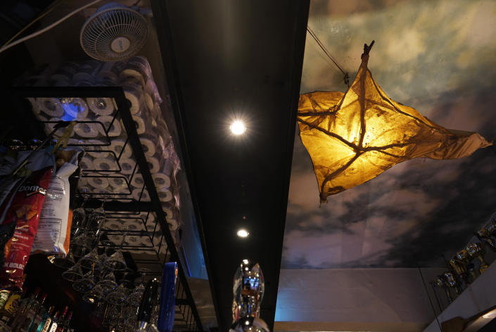This Oct. 7, 2020 photo shows an interior view at Club 71 in Hong Kong. The bar known as a gathering place for pro-democracy activists and intellectuals is closing. (AP Photo/Vincent Yu)