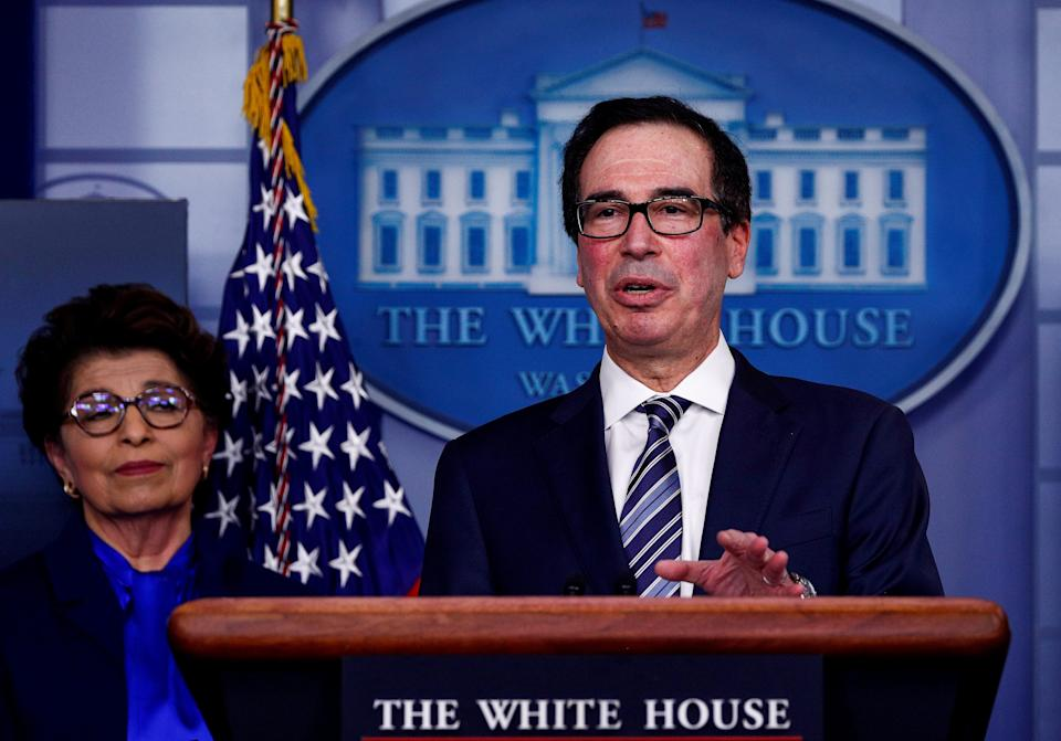 FILE PHOTO: Treasury Secretary Steven Mnuchin discusses details for economic relief during the daily coronavirus response briefing as Small Business (SBA) Administrator Jovita Carranza listens at the White House in Washington, U.S., April 2, 2020. REUTERS/Tom Brenner