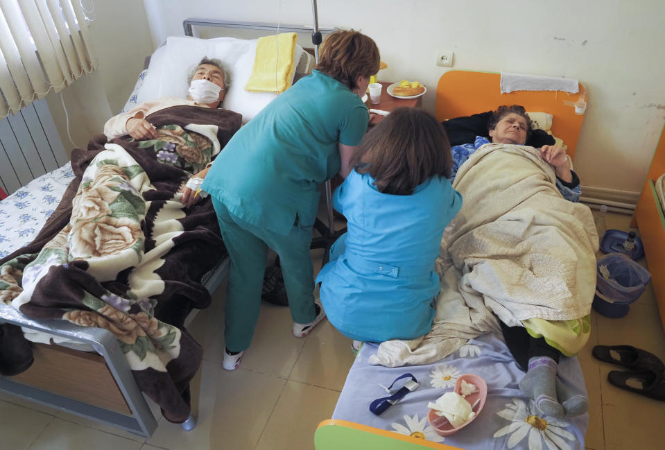 Nurses administer medicine to a patient wounded from shelling by Azerbaijan's artillery in a hospital, during a military conflict in Stepanakert, the separatist region of Nagorno-Karabakh, Saturday, Oct. 17, 2020. The latest outburst of fighting between Azerbaijani and Armenian forces began Sept. 27 and marked the biggest escalation of the decades-old conflict over Nagorno-Karabakh. The region lies in Azerbaijan but has been under control of ethnic Armenian forces backed by Armenia since the end of a separatist war in 1994. (AP Photo)