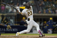 San Diego Padres' Fernando Tatis Jr. swings while batting during the sixth inning of a baseball game against the Milwaukee Brewers, Monday, April 19, 2021, in San Diego. (AP Photo/Gregory Bull)