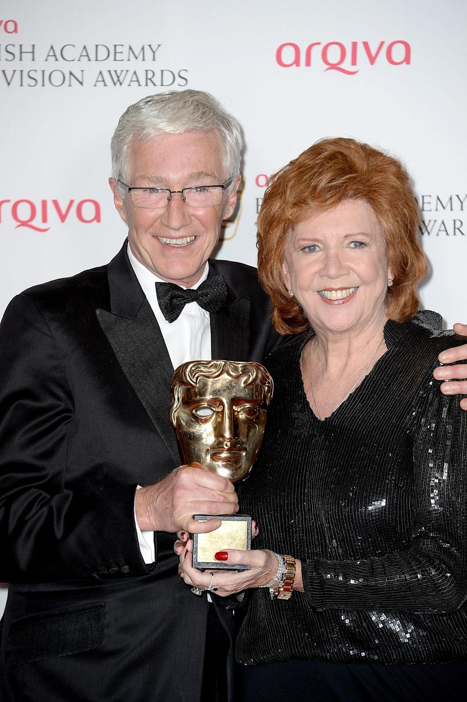 LONDON, ENGLAND – MAY 18: Cilla Black accepts the Bafta Special Award for her service to entertainment with Paul O'Grady at the Arqiva British Academy Television Awards at Theatre Royal on May 18, 2014 in London, England. (Photo by Dave Hogan/Getty Images)