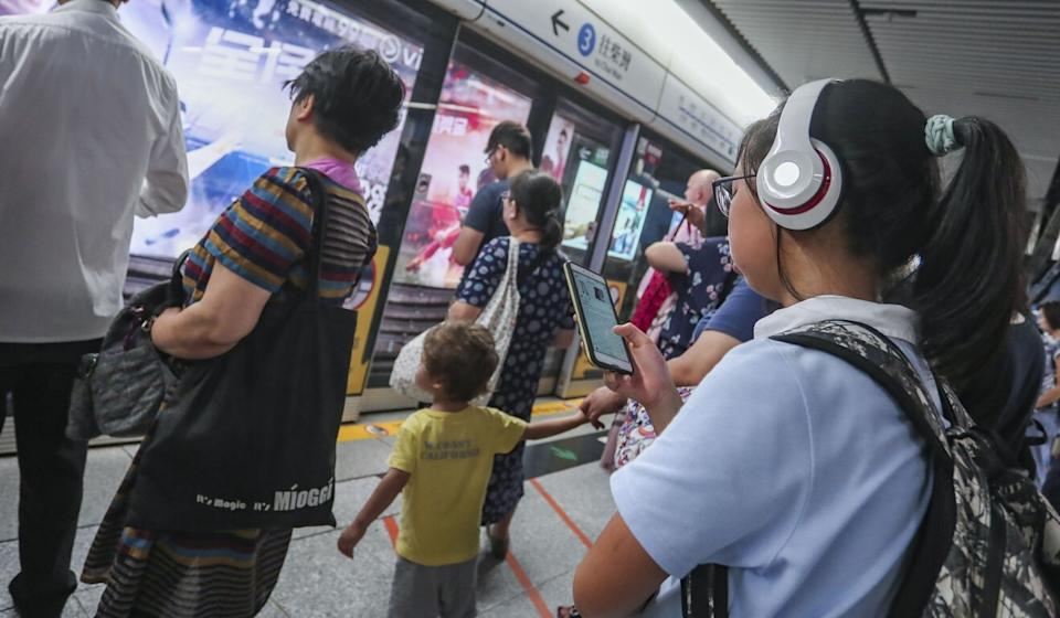 A student on her smartphone on a MTR platform in Hong Kong. Photo: Jonathan Wong