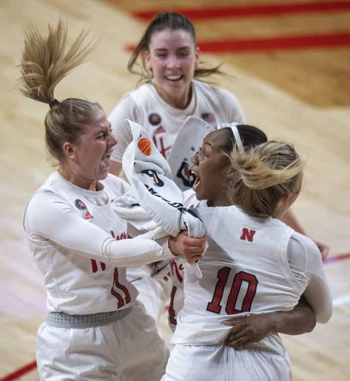 Nebraska's Sam Haiby, center right, celebrates her layup at the buzzer which handed the Huskers a win over Northwestern in an NCAA college basketball game Thursday, Dec. 31, 2020, in Lincoln, Neb. (Francis Gardler/Lincoln Journal Star via AP)
