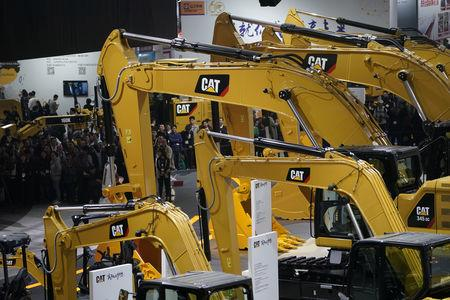 FILE PHOTO: People visit heavy machinery of Caterpillar at Bauma China, the International Trade Fair for Construction Machinery in Shanghai, China November 27, 2018. REUTERS/Aly Song