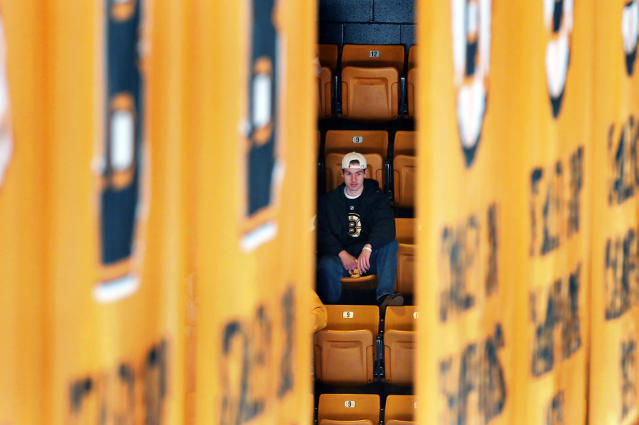 A Boston Bruins fan waits for the start of Game 5 in the first round of the NHL hockey Stanley Cup playoffs between the Bruins and the Detroit Red Wings in Boston, Saturday, April 26, 2014. The Bruins lead the best-of-seven games series 3-1. (AP Photo/Michael Dwyer)