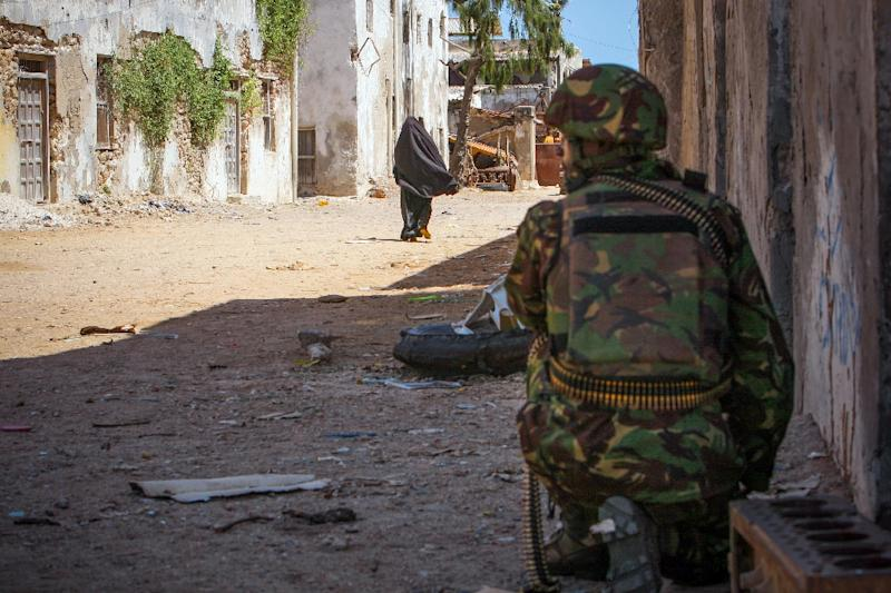 A soldier of the Kenyan contingent serving with the African Union Mission in Somalia (AMISOM) keeps watch on a street in the centre of the southern port city of Kismayo, in a photo taken on October 5, 2012