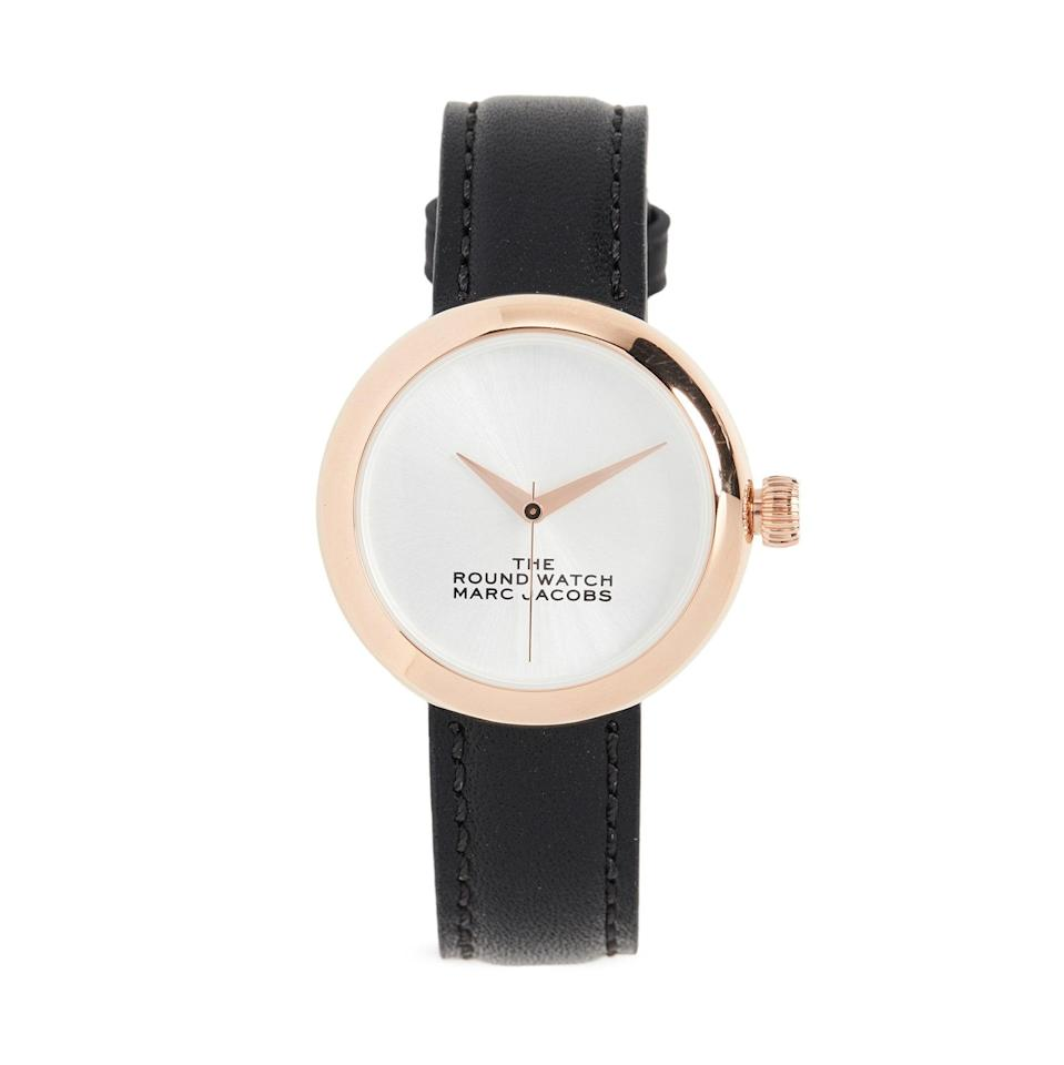 """First up: A perennial classic for the minimalist shopper. This Marc Jacobs watch makes a subtle statement with its delicate black band, number-less clock face, and rose gold accents. $275, Shopbop. <a href=""""https://www.shopbop.com/round-watch-marc-jacobs/vp/v=1/1589352894.htm"""" rel=""""nofollow noopener"""" target=""""_blank"""" data-ylk=""""slk:Get it now!"""" class=""""link rapid-noclick-resp"""">Get it now!</a>"""