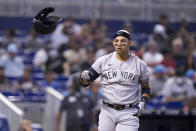 New York Yankees' Rougned Odor tosses his helmet after he struck out swinging during the fourth inning of a baseball game Miami Marlins, Sunday, Aug. 1, 2021, in Miami. (AP Photo/Lynne Sladky)