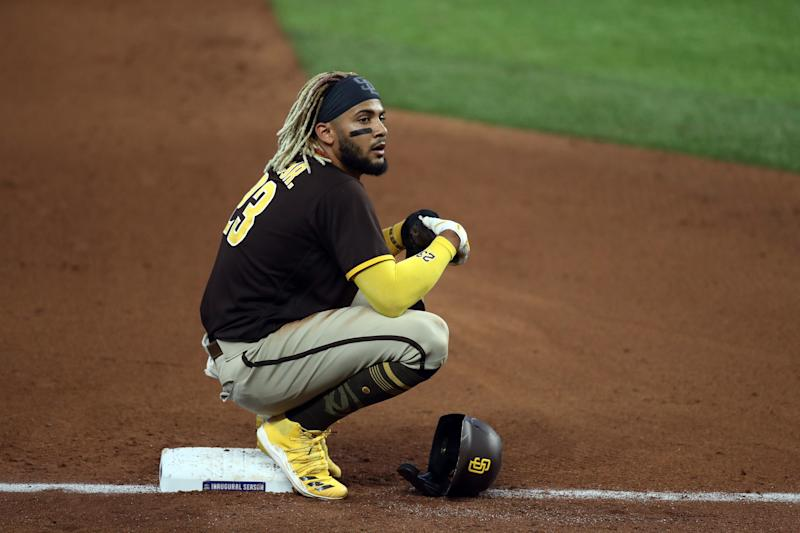 ARLINGTON, TEXAS - AUGUST 18: Fernando Tatis Jr. #23 of the San Diego Padres sits on third base during a play review against the Texas Rangers in the fourth inning at Globe Life Field on August 18, 2020 in Arlington, Texas. (Photo by Ronald Martinez/Getty Images)