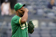 Oakland Athletics relief pitcher Yusmeiro Petit reacts after giving up a game-tying RBI single to New York Yankees' Giancarlo Stanton in the seventh inning of a baseball game, Saturday, June 19, 2021, in New York. (AP Photo/John Minchillo)