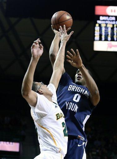 Brigham Young's Brandon Davies, right, shoots over Baylor's Isaiah Austin during the first half of an NCAA college basketball game, Friday, Dec. 21, 2012, in Waco, Texas. (AP Photo/Waco Tribune Herald, Rod Aydelotte)