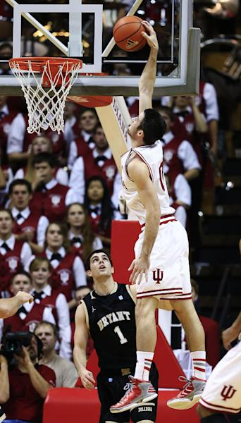 Indiana's Will Sheehey dunks against Bryant's Corey Maynard during the first half of an NCAA college basketball game, Friday, Nov. 9, 2012, in Bloomington, Ind. (AP Photo/Darron Cummings)